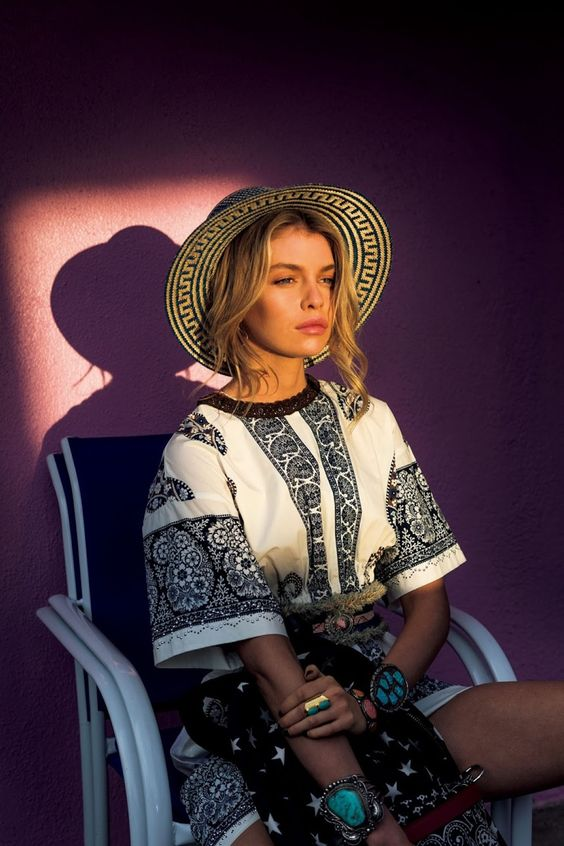 Stella Maxwell wears straw hat with printed dress