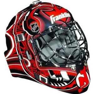 Franklin NHL Team SX Comp GFM 100 Youth Goalie Face Mask - New Jersey Devils. This New Jersey Devils-themed face mask helps protect young goalies in the net while playing street hockey. Featuring true NHL style, with a chrome-finished welded steel cage and high-impact ABS plastic for reducing potential injury, this face mask is designed only for street hockey use with an official street hockey ball (not included). Adjustable elasticized quick-snap straps and an extended, contoured chin and…