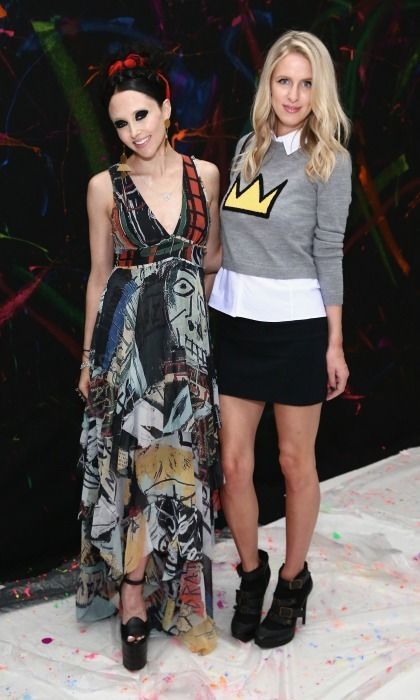 Stacey Bendet and Nicky Hilton celebrated the launch of the alice + olivia x Basquiat CFDA Capsule Collection in NYC wearing chic pieces from the line, which features the late artist's work.