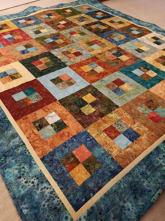 Made by Anita Pacey. I used a jelly roll for this quilt.