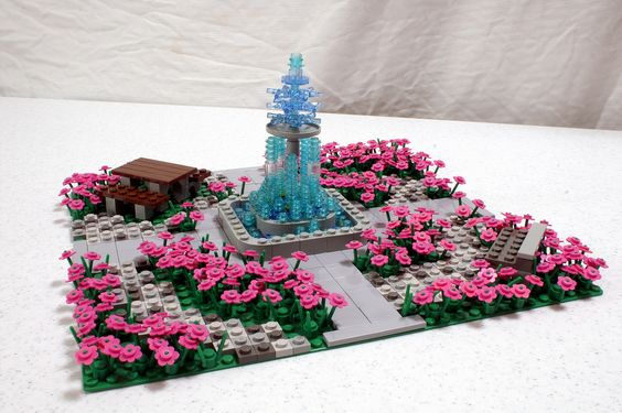 https://flic.kr/p/61pUZx   Christina's Garden   The LEGO Store's PaB got some new stock, specifically pink flowers and trans blue 1x1 round plates.  They inspired my wife to build this garden.  Yup, my wife plays with LEGO.  Jealous?  You should be.