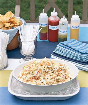 Nestle bowls of cold foods (like coleslaw) in a larger bowl of ice to keep them cool at an outdoor buffet.