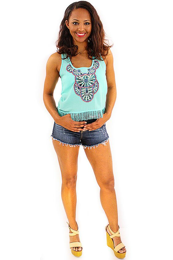 Medallion Fringe Tank - Summer is in the air with this mint embroidered fringe tank! A cropped tank fringed with tassels at the hem. And a large black, cream, and pink embroidered medallion at the neckline giving a bohemian flair. Fun simply paired with denim cutoffs and wedges for a funky casual summer night out outfit.  - available online at http://www.envyboutique.us/shop/medallion-fringe-tank/ #Envy #Boutique #chic #fashion #fashiontrends #FringeTank, #MintCroppedTop, #Mi