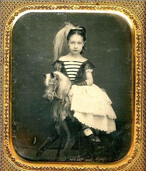 Girl on Rocking Horse...: