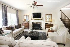 maybe just white walls? and is it too wide to stretch the seating area across the room, from long wall to window, with a big coffee table in between? (but then how would traffic flow through the area?) (nest for less family room makeover)