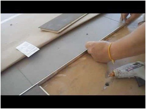 Metal Transition Strip Between Hardwood Flooring And Tile How To Install Youtube Ceramicfl Transition Strips Tile To Wood Transition Floor Transition Strip