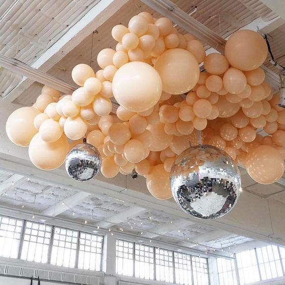 K'Mich Weddings - wedding planning - decoration - peach balloons hanging from a ceiling