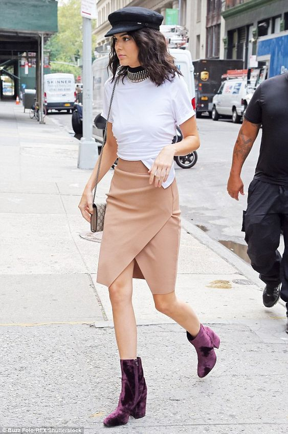 Nice kicks: The Keeping Up With The Kardashians star modeled purple velvet short boots:
