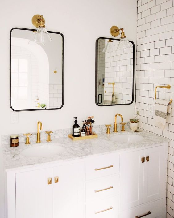 Minimal black and white subway tile bathroom with brass accents