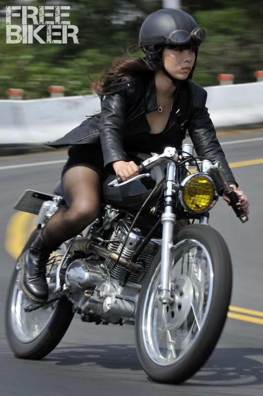 Women riding motorcycles in a mini skirt perhaps shall
