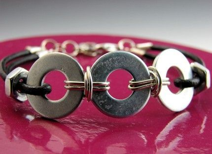 Washer bracelet - washers, wire, leather, nuts, clasp.  Just has a picture.  Easy to make myself?