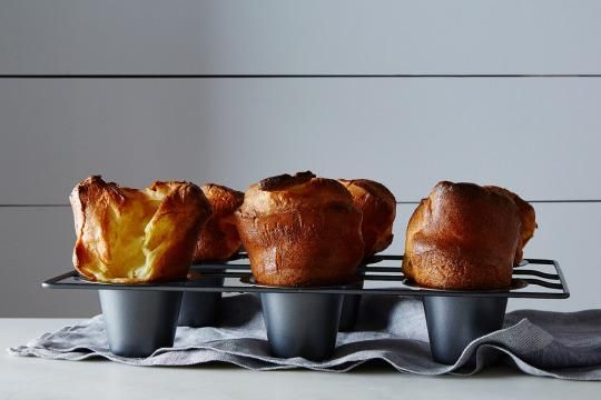 The first time I saw a popover, I was certain that it was magic. A TV chef whisked the batter together in a total of 3 minutes and said that in 20 minutes he would have towering, warm popovers, which just didn't seem possible.