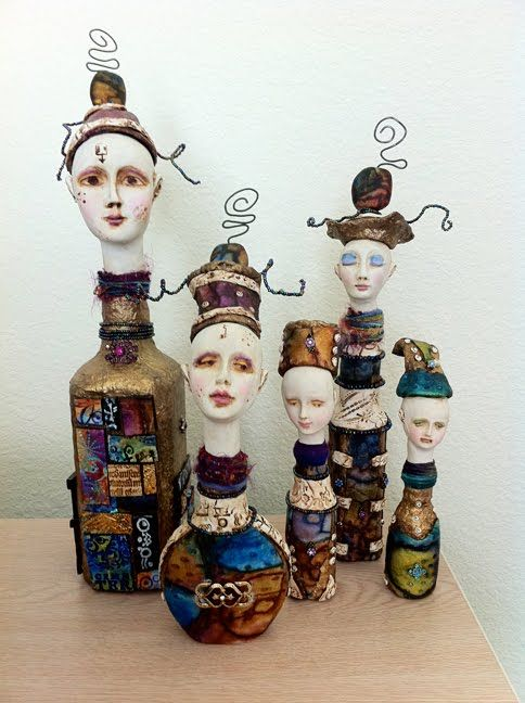 Alladin's Genies from Tricia Dewey Polymer clay, wire, fabric and paint on bottles: