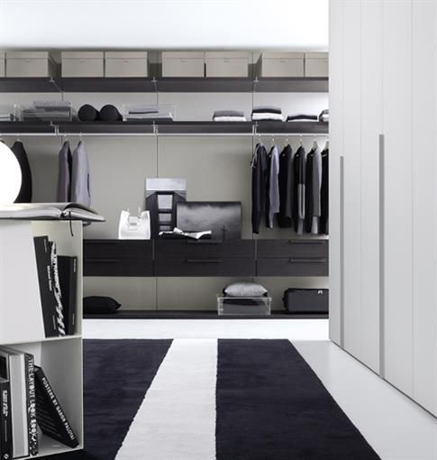 Mens Wardrobe - Available with mirrored or lacquered glass doors, with a glass or satin lacquered finished. The Ghost wardrobe frame is titanium with a matching integrated long handle.