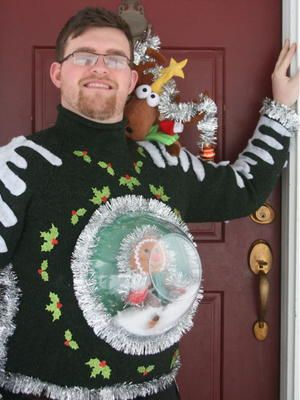 Learn how to make an uncommon DIY ugly Christmas sweater with this Snow Globe DIY Ugly Sweater tutorial. By using a clear plastic bowl, you will give the illusion of a snow globe bursting out of the front of your homemade ugly Christmas sweater.: