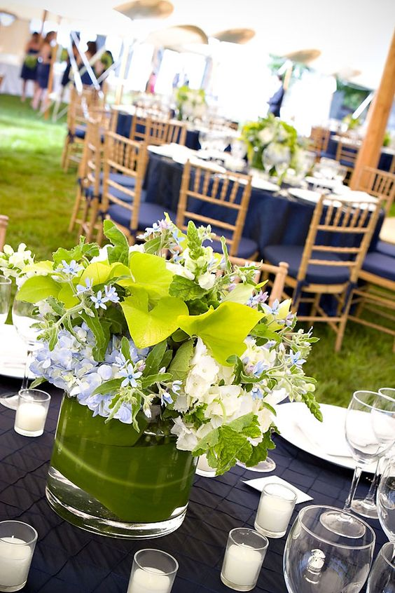 tablescape - navy and green low centerpiece - use of natural greens.  Maybe a bit more white, add candlelight  Pink or coral pop through menu, placecards, napkins?
