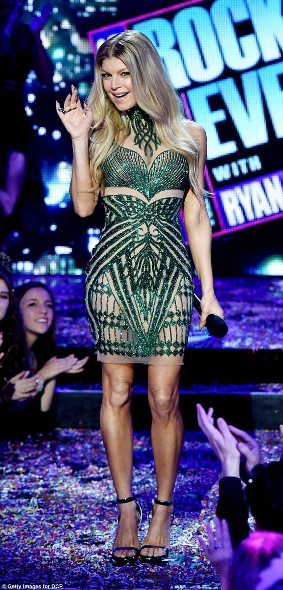 Happy NYE! Fergie from the Black Eyed Peas wore a dazzling green and nude rhinestone dress...