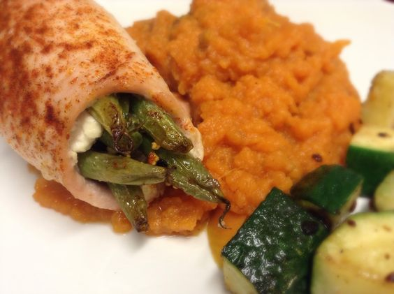 Green bean and feta turkey roll-up with sweet potato mash and grilled eggplant.