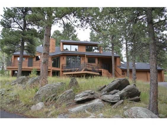 Genesee Mountain Contemporary! Beautiful open floor plan, new kitchen, nice mountain and distant snow cap views!