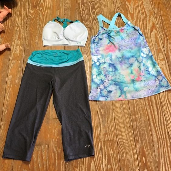 Champion Workout Outfit  Champion Workout Outfit... Includes Capris Size Small, Sports Bra Small, Workout Shirt Small Champion Other