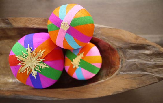 MAKE A SURPRISE BALL ORNAMENT (via http://honestlywtf.com/diy/diy-surprise-balls/). Crepe paper. Fortune Fish. mustache. Balloon. Eye patch. Hot wheels. Clear snap ornament in center. Easter egg in center .