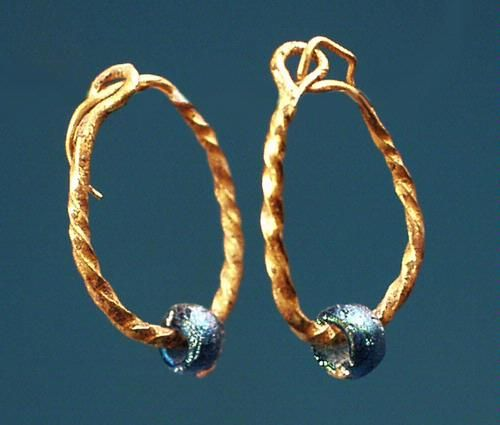 A pair of ancient Roman gold earrings with twisted hoops and blue glass beads.Ca. 1st - 3rd century CE.  .Height: 5/8 in. ( 16 mm). Intact, excellent condition. Formerly in a European private collection.:
