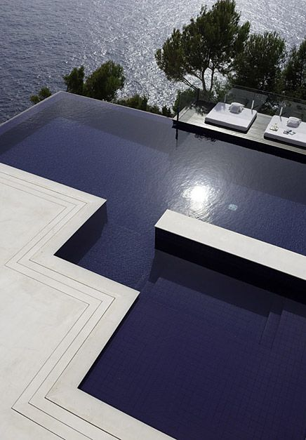 This huge pool has several sections and a modern shape to go along with it. What really makes it more modern still, however, is the infinity edge that goes right over the edge of a cliff.