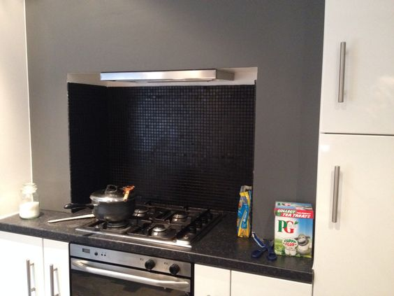 Small oven cooker in chimney breast fireplace