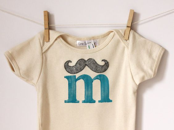 M is for Mustache  American Apparel Organic by LittleBlueFeathers, $14.95    Or M is for Maggie lol i think I must buy this