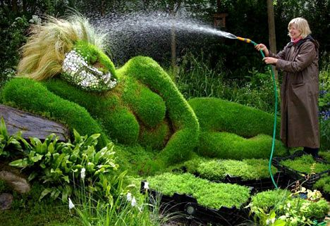 4Head Healing Garden, an entry to the Chelsea Flower Show, exhibits a reclining woman mud sculpture made by Sue and Peter Hill