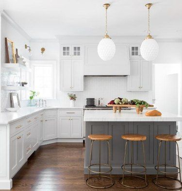 Forecast Gray Islands Are Taking Over White Kitchens And We Predict Sunny Feelings For Everyone Hunker In 2020 Kitchen Island Decor Modern Kitchen Island Grey Kitchen Designs