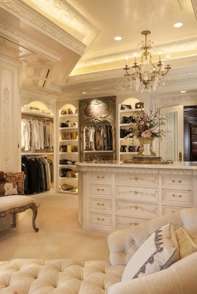 Large walk-in closet with storage shelves, cabinets and cozy sofa #closet #storage #organization #allenrothCloset #allenAndRothCloset #closetShelves