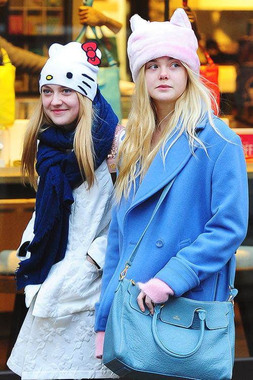 Elle and Dakota Fanning take to the streets of Korea in these cute Hello Kitty hats!