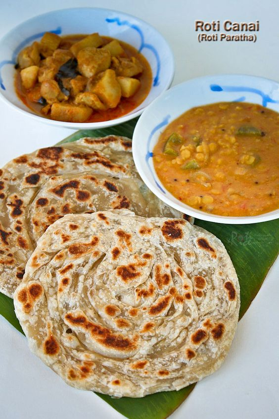 Crispy and fluffy homemade Roti Canai (Roti Paratha) with step-by-step instructions. Delicious eaten with dhal and chicken curry.   RotiNRice.com