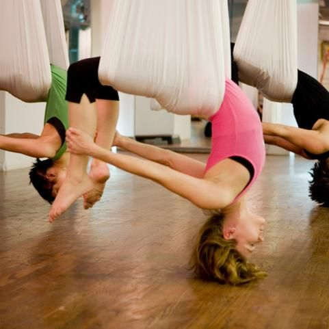 Anti-Gravity Yoga!  I want to try this! this would be so so fun!