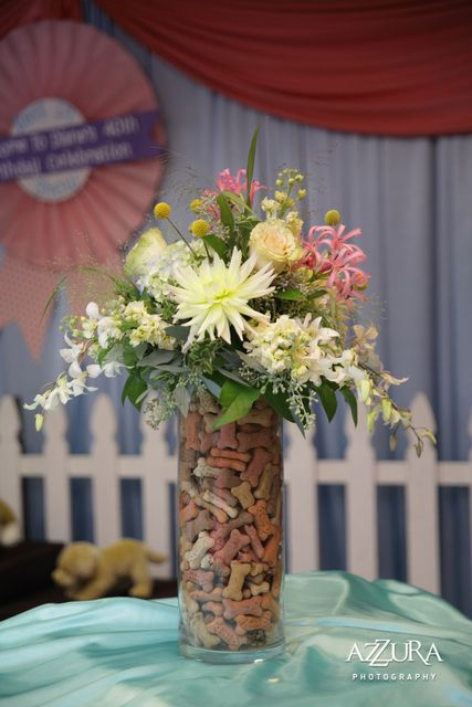 Puppy Themed Party (Minus the Flowers) - cylinder vase with dog bones is kind of cute...