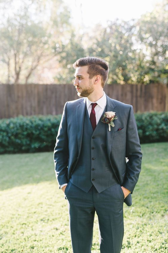 Groom's Suit: Dark gray with a burgundy tie  #crosscreekranchfl Professional Photo by Kera Photography  #groomsattire #groomssuit #groomfashion #weddingattire #weddingfashion