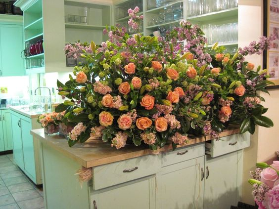 I think this is a casket arrangement. I'm pinning it for the color scheme - apricot and lavender. (design by Martha E. Harris Flowers and Gifts)