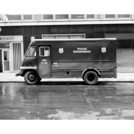 Police van parked in front of a building Canvas Art - (18 x 24)