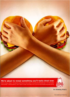 This ad is promoting the new burger at Arby's and implies that the reveal will be as exciting as a woman's breasts are. It is meant to attract men by employing creative strategies to obtain the consumers attention and provoke them. This is an example of visual persuasion in advertising.  http://amandaroe.blogspot.com/2012/12/thinking-visually-you-are-now-final.html