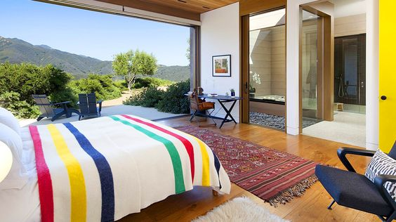 Real Estate Envy: 7 Dreamy Vacation Homes // bedroom, Pendleton blanket, kilim rug, Flokati rug, patio