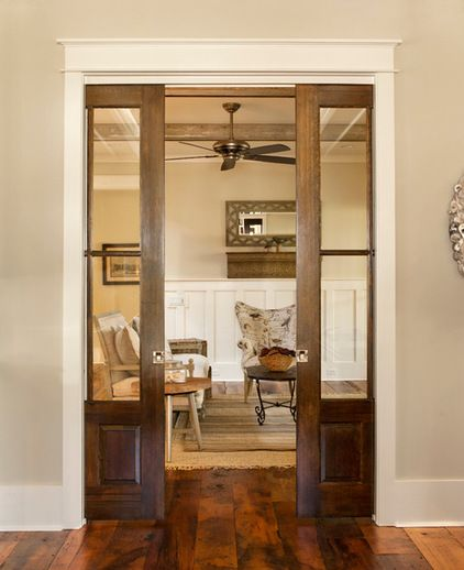 Pocket Doors :-) beach style living room by Visbeen Architects