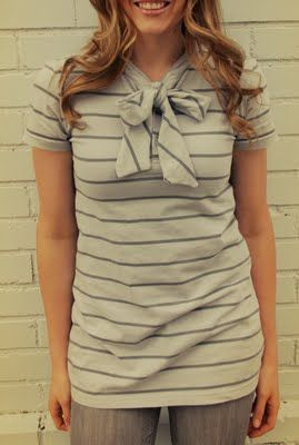 DIY Re-purposed Men's Shirts Made from an oversized men's polo shirt and transformed into this bow-tie blouse.