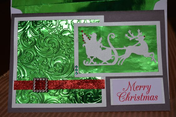 Made with green foil, Darice embossing folder, and Cricut Dec 25th cartridge. Stamped the Merry Christmas and used red glitter tape. Used the rest of the foil to line the envelope to match.