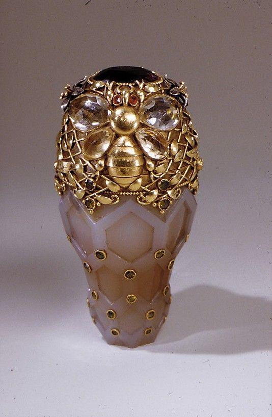 Gold, agate, yellow sapphires, dementoid garnets, red garnets, and amethyst Tiffany perfume bottle