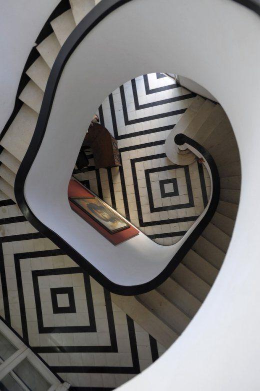 An Art Deco-inspired staircase in a house designed by Havana architect Rafael de Cárdenas.