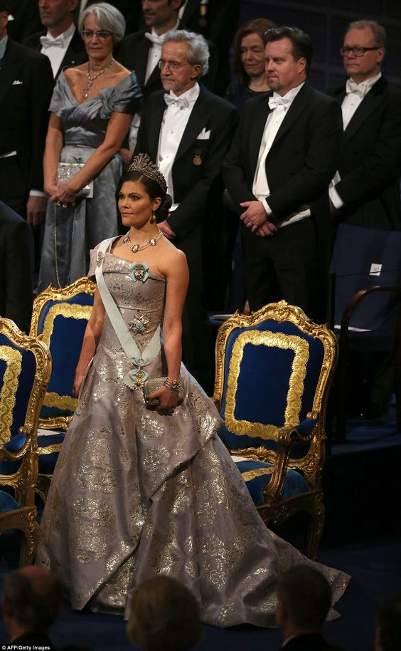 Crown Princess Victoria of Sweden stands for her anthem before the Nobel Prizes in medicine, economics, physics and chemistry were awarded