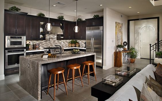This gourmet kitchen features plenty of counterspace and a for Gourmet kitchen islands