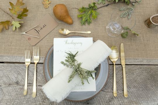 In the Veggie Kitchen: Thanksgiving Decor | Gold flatware + white fabric napkin with green napkin ring