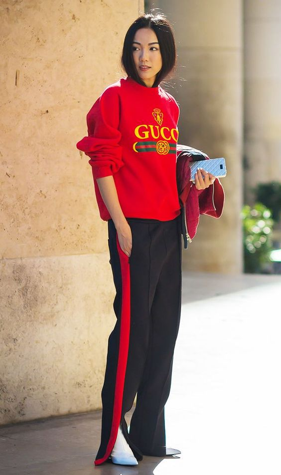 We're so into how she coordinated her sweatshirt with the side stripe of her pants.